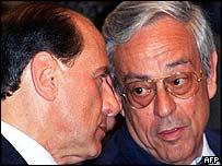 Italian Prime Minister Silvio Berlusconi (L) and lawmaker Cesare Previti (R) in Rome in 1997