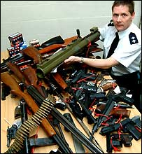 The rocket launcher and a range of other surrendered weapons