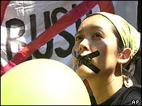 Protester with tape over her mouth at protest in Krakow