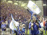 Pompey fans celebrate their promotion to the Premiership