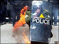Policeman confronting unrest