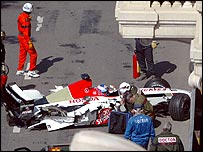 Jenson Button awaits medical attention in his BAR after his 180mph crash at Monaco
