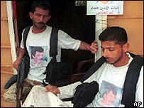 PLF fighters in lebanon read news of their leader's arrest
