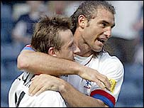 Goalscorer Lorenzo Amoruso (right) celebrates with Neil McCann