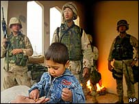 Iraqi child receives candy at a US checkpoint in Tikrit