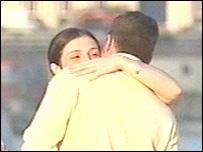 A couple embrace