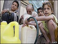 Young and old fetch water in Baghdad