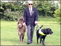 Stuart May with a guide dog and horse