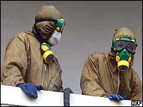 Troops wearing protective clothing at French hospital in Hanoi