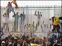 Refugees breakout from the Woomera Detention Centre in March 2002