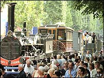 People walk by an 1852 train on Champs Elysees in Paris