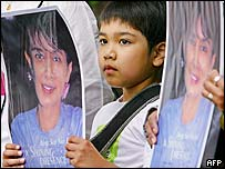 Burmese boy holds a picture of opposition leader Aung San Suu Kyi during a demonstration in Tokyo