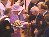 The Queen handing out the Maundy money