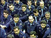 Iranian army officers listen to a speech