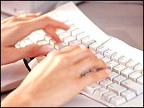 Women typing on a keyboard