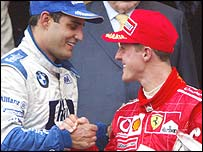 Juan Pablo Montoya and Michael Schumacher on the podium in Monaco