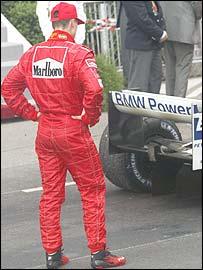 Michael Schumacher inspects Juan Pablo Montoya's winning Williams after the Monaco Grand Prix