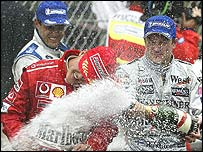 Winner Juan Pablo Montoya (left), third placed Michael Schumacher (centre) and runner-up Kimi Raikkonen spray the champagne after Sunday's Monaco Grand Prix