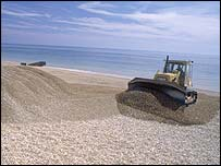 Bulldozer on shingle beach   English Nature