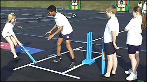 Children get playing Kwik-Cricket at school