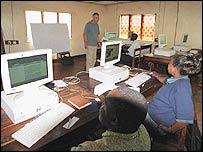 Refugees at a computer class