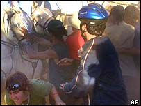Protesters try to avoid police horses during a protest outside the Baxter Detention Facility in Port Augusta