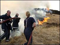 Firefighters tackling a grass fire at Belmont, Lancashire