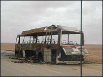 Burnt-out bus on highway to Baghdad