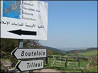 Signpost in French and Arabic