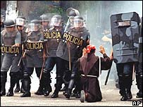 A Franciscan friar, Francineto Abreu Pinheiro, pleads for calm during a stand-off between police and landless campaigners