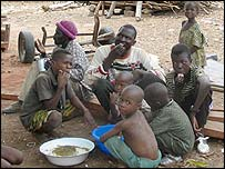Siby villagers eating rice