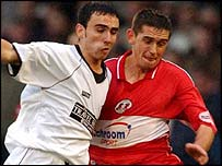 Leon Britton (left) in action for Swansea