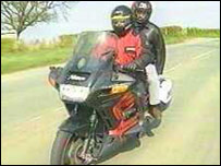 Motorcyclist and pillion passenger