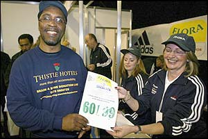 Michael Watson picks up his race number at the start of the week