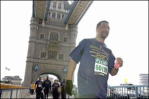 Watson crosses Tower Bridge on Tuesday as he reaches the halfway point