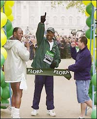 Michael Watson crosses the finish line