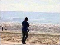 A person walking on a beach