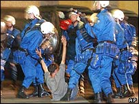 A protester is arrested in Geneva