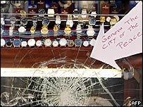 Sign on smashed jewellery shop