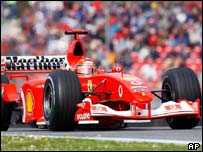 Michael Schumacher races round his qualifying lap at Imola