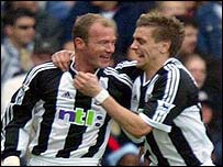 Shearer is congratulated by Jonathan Woodgate after his opener against Fulham