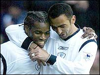 Jay-Jay Okocha (left) and Youri Djorkaeff celebrate the Nigerian's goal