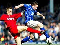 Liverpool's Igor Biscan challenges Everton's Wayne Rooney