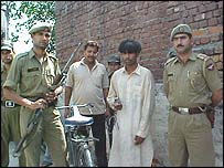 Mohammad Ishfaq (second from right) and his bicycle
