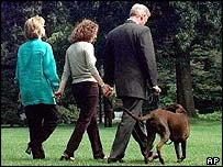 Hillary, Chelsea and Bill Clinton with Buddy the dog; August 1998