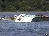 Capsized ferry and rescuers