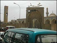 Baghdad's Azamiya mosque with damage visible to the clock tower (left) and one of the main gates