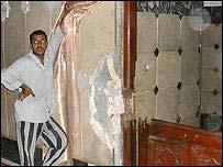 The broken frame and door of Abu Hanifa's tomb