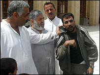 Looter held by men at Azamiya mosque
