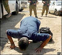 A released Palestinian prisoner kisses the ground after his release in Tulkarm